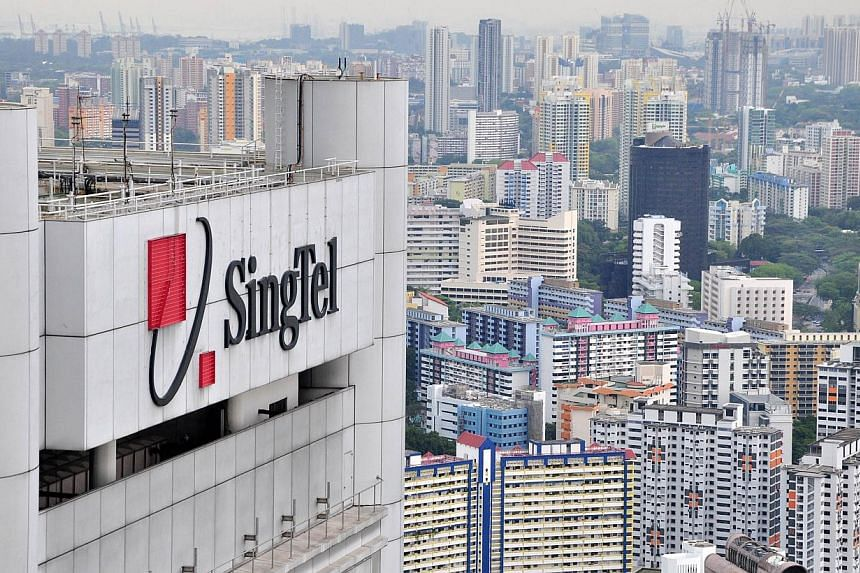 Singapore Telecommunications' fourth-quarter net profit climbed 4 per cent from a year earlier but came in shy of analysts' expectations, hurt by unfavourable exchange rates and a lacklustre performance from its group enterprise business. -- FILE PHO