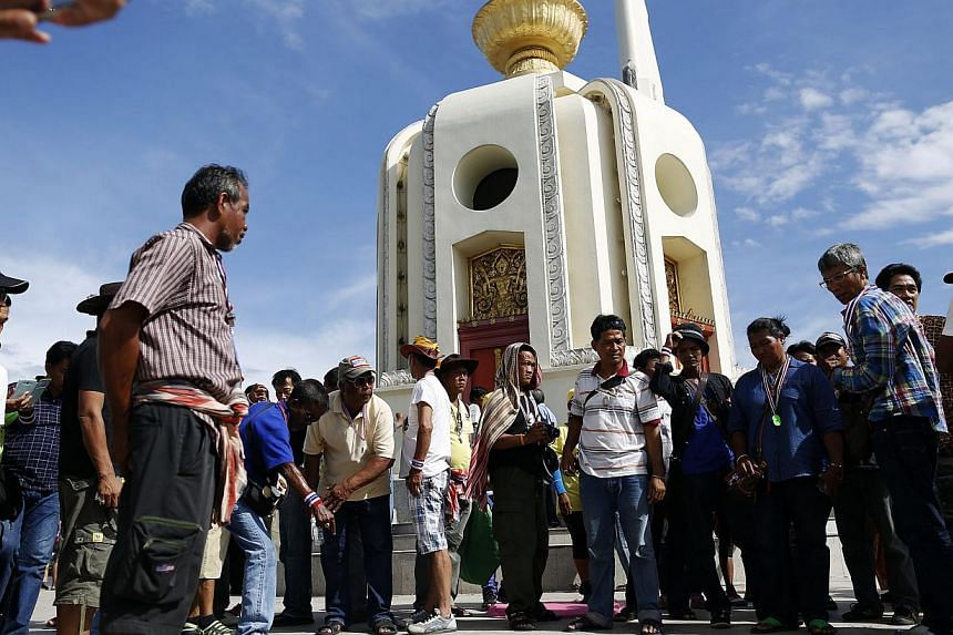 Anti-government protesters gather at the site of an attack at the Democracy Monument in Bangkok on May 15, 2014. -- PHOTO: REUTERS