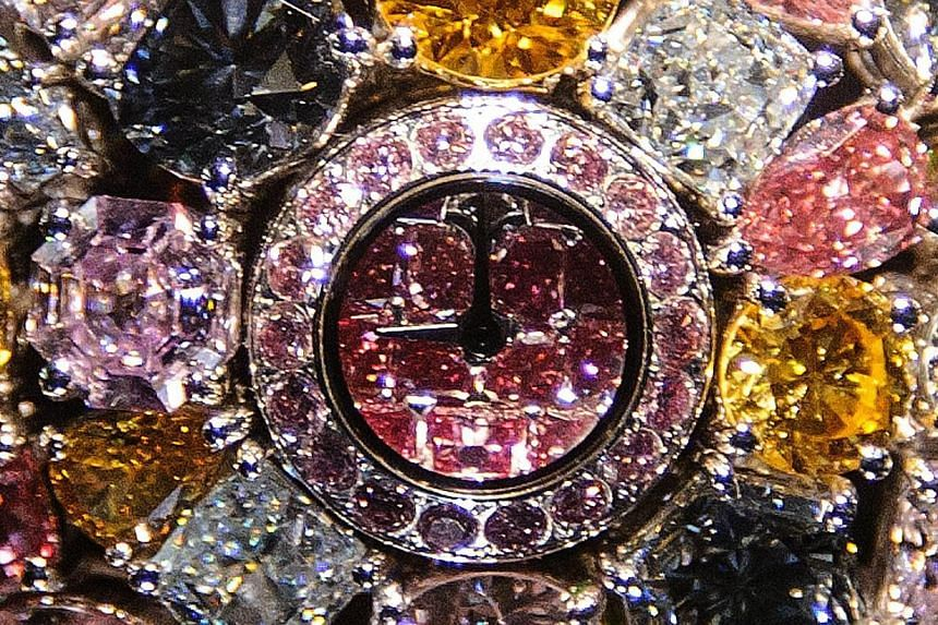 "A US$55 million ""Hallucination"" watch set with a multitude of rare coloured diamonds is displayed at the booth of British jeweller Graff at the watch industry's biggest annual tradeshow BaselWorld on March 28, 2014 in Basel. British jeweller Graff de"