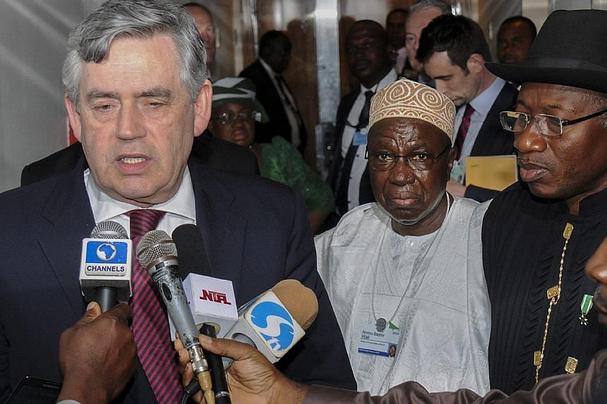 President of Nigeria, Goodluck Jonathan (right), looks on as former British Prime Minister Gordon Brown (left) speaks to journalists in Abuja, Nigeria, on 09 May 2014. -- FILE PHOTO: EPA
