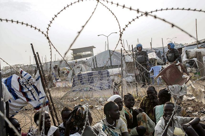 South Sudanese women waiting in line for food distribution inside the UNMISS compound in Juba on February 24, 2014.At least one person has died in war-torn South Sudan of highly contagious cholera with several others infected, sparking concern