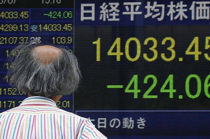Tokyo stocks opened 1.47 per cent lower on Friday following a drop on Wall Street and hit by the yen's rise against the dollar. -- FILE PHOTO: EPA