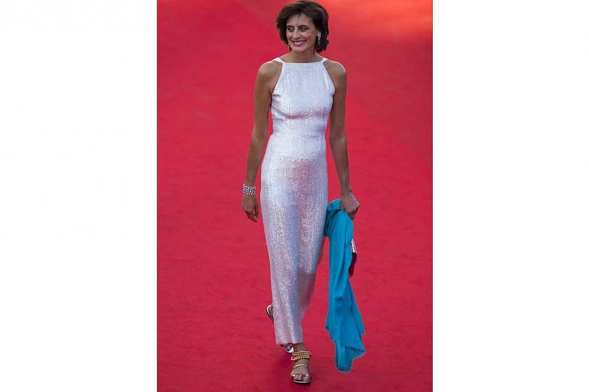 Trust a French woman to pull off the seemingly impossible combination of casual chic and red carpet glitz. Designer Ines de la Fressange does it with a sleek silver column of a dress, accessorised by gold beaded slippers and bangles, and a bright aqu