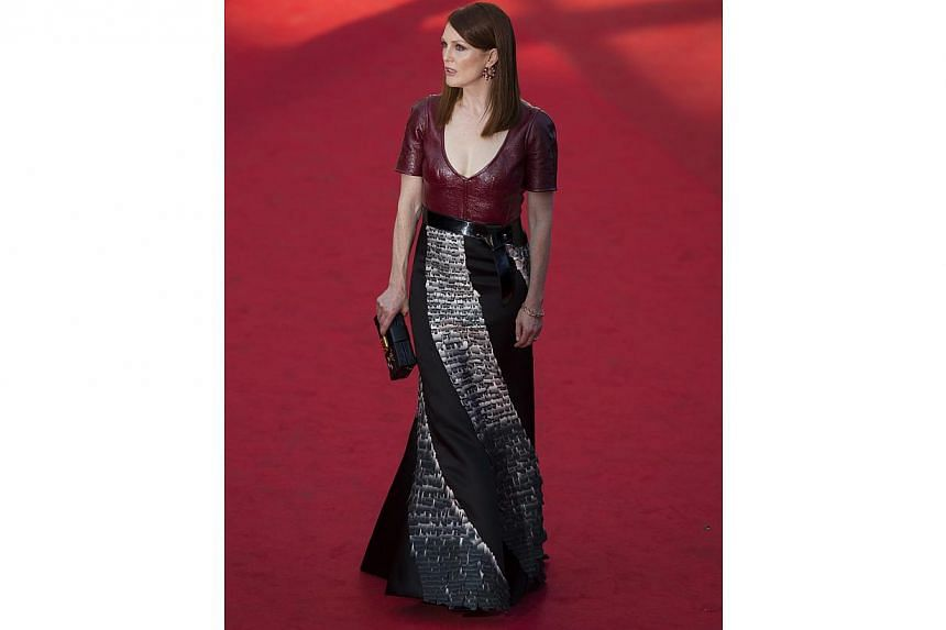 Oh dear. We don't know what is worse: The leather top that looks mumsy despite the edgy material, or the weird spiral embroidery satin skirt in this disaster of a customised Louis Vuitton dress. Which is a pity because from the neck up, actress Julia