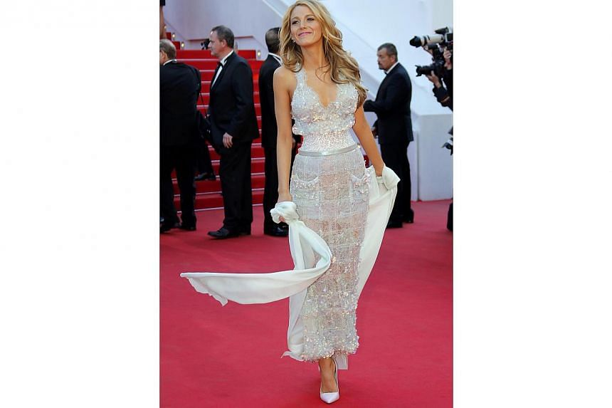 Actress Blake Lively has been quite the fashion plate this past couple of weeks. This sparkling Chanel dress accented her cleavage and showed off her tiny waist with a corset detailing. The silk kimono she wore in a shawl drape was rather unnecessary