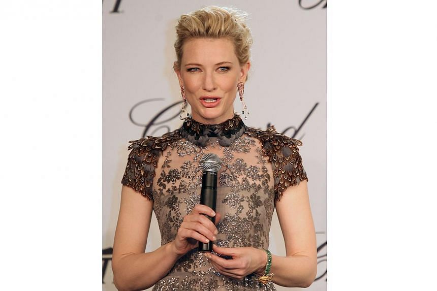 Australian actress Cate Blanchett is gorgeous as always in a dainty gray metallic Valentino. But it is the quirky Chopard earrings that add an unexpected touch of fun - they are in the shape of prawns.-- PHOTO: AFP