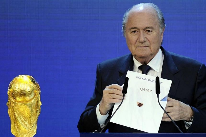 Fifa President Sepp Blatter holding up the name of Qatar during the official announcement of the 2022 World Cup host country at the Fifa headquarters in Zurich on Dec 2, 2010. Blatter has said it was a mistake to choose Qatar to host the 20