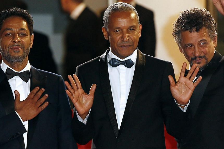 (From left) Tunisian actor Hichem Yacoubi, Mauritanian director Abderrahmane Sissako and Tunisian-born actor Abel Jafri pose as they arrive for the screening of their film Timbuktu at the Cannes Film Festival. The film is one of several to bring the