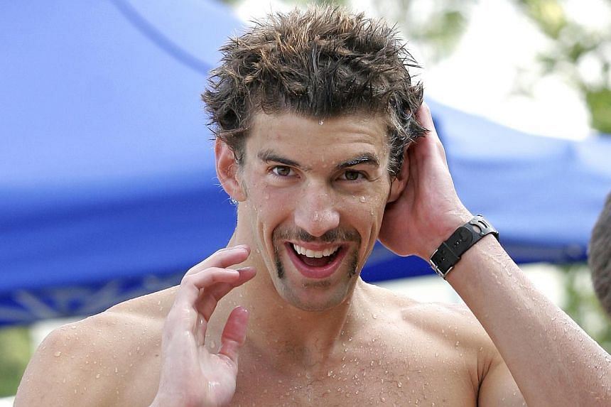 Michael Phelps will take another small step in his comeback to competitive swimming when he competes in two races on Friday but this time he will do it without the presence of his friend and greatest rival. -- ST FILE PHOTO: ADELINE ONG