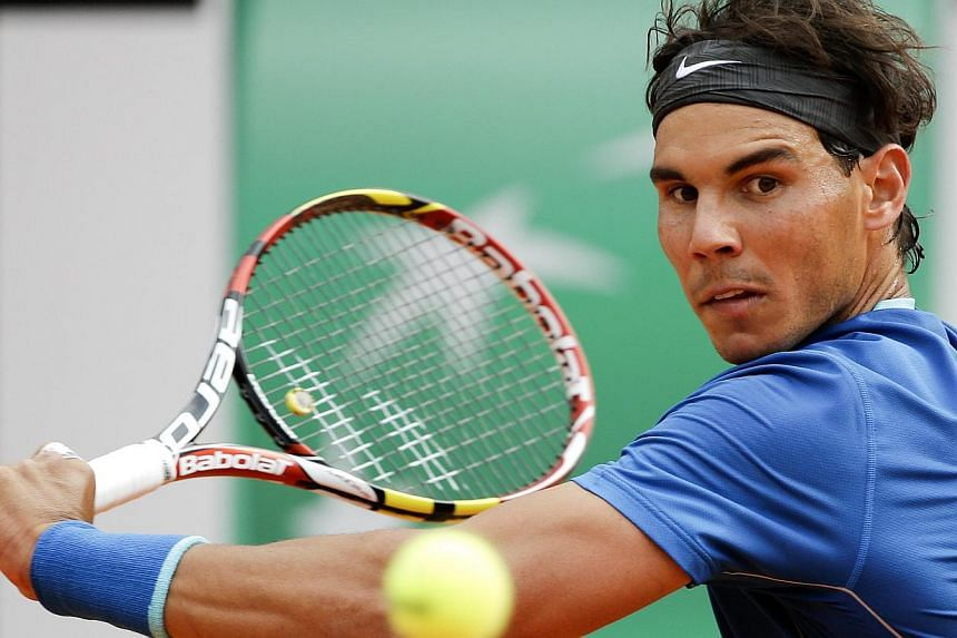 Rafael Nadal of Spain hits a return to Mikhail Youzhny of Russia during their men's singles match at the Rome Masters tennis tournament on May 15, 2014. -- PHOTO: REUTERS