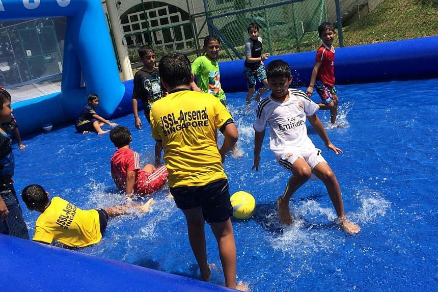 At Kovan Sports Centre, one can opt to play soccer in ankle-deep water in an inflatable pool. -- PHOTO: KOVAN SPORTS CENTRE