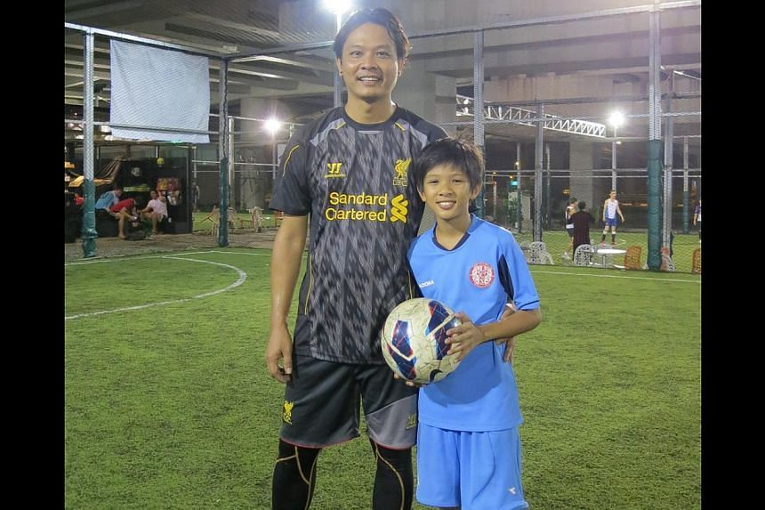 Zuriel Sharul Isaac, 12, joins his father, Mr Sharul Isaac, who plays five-a-side soccer with his friends at Offside, a pitch located under a flyover in Whitley Road. -- PHOTO: ELRICA TANU