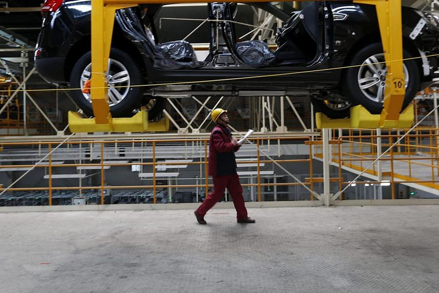 A worker at a Chinese car factory in Hefei, Anhui province. The attractiveness of Chinese and American markets to foreign firms depends on the profits to be made in international terms, not as measured by the workers' domestic purchasing power.