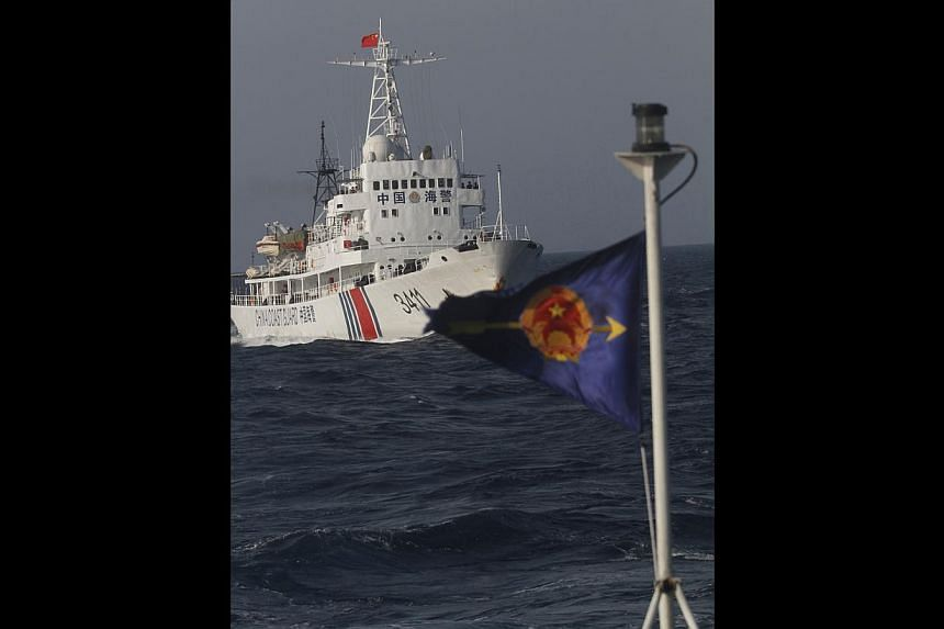 A Chinese coast guard ship (left) and a Vietnamese marine guard vessel (flag on right) in the South China Sea, about 210km off the shores of Vietnam, on Wednesday.