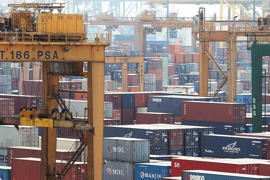 Exports from Singapore rose last month, beating economists' expectations. -- ST FILE PHOTO:ONG WEE JIN