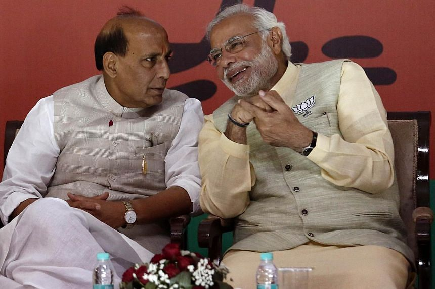 Bharatiya Janata Party prime ministerial candidate Narendra Modi (R) seen with with his party's president Rajnath Singh in New Delhi April 7, 2014. -- PHOTO: REUTERS