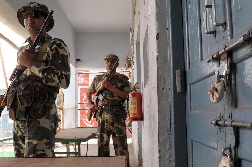 Indian paramilitary soldiers stand guard outside a sealed 'strong room' where Electronic Voting Machines (EVM) are kept, on the eve of the announcement of the results of the Lok Sabha - lower house -elections. India's triumphant right-wing opposition