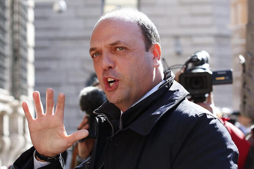 Italy's Interior Minister Angelino Alfano is working on a proposal for lifetime stadium bans for football hooligans following violence before this month's Cup final in which three Napoli fans were shot. -- FILE PHOTO: REUTERS
