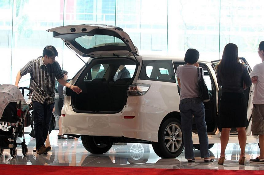 Potential car buyers and members of public at the Toyota showroom on March 17, 2013. Singapore is the most expensive place in the world to buy a car, according a survey by Deutsche Bank. -- ST FILE PHOTO: NEO XIAOBIN