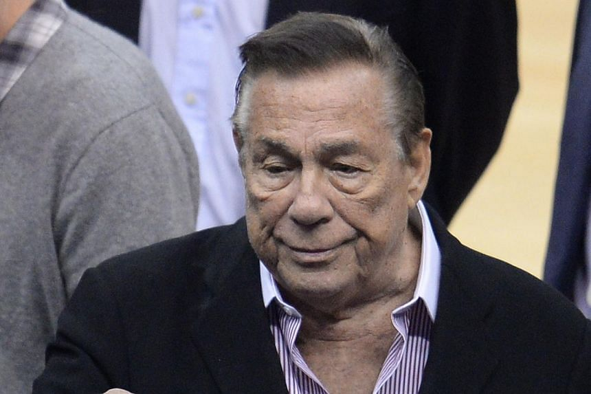 This April 21, 2014 file photo shows Los Angeles Clippers owner Donald Sterling attending the NBA playoff game between the Clippers and the Golden State Warriors at Staples Center in Los Angeles, California. Sterling, who was banned for life fro