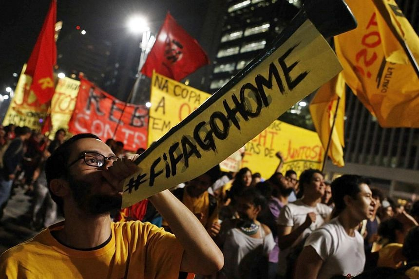 A demonstrator blows a horn during a protest against the 2014 World Cup, in Sao Paulo on May 15, 2014.Brazil faced a test of its security preparations for the World Cup on Thursday as demonstrators aghast at the cost of the event joined protest