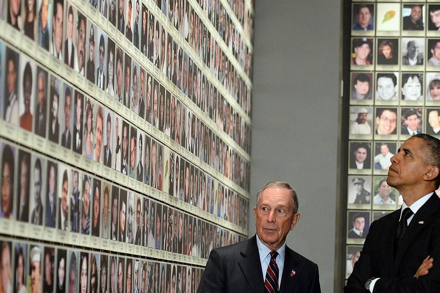 US President Barack Obama is accompanied by former New York Mayor Michael Bloomberg as he tours the National September 11 Memorial & Museum on May 15, 2014 in New York. -- PHOTO: AFP