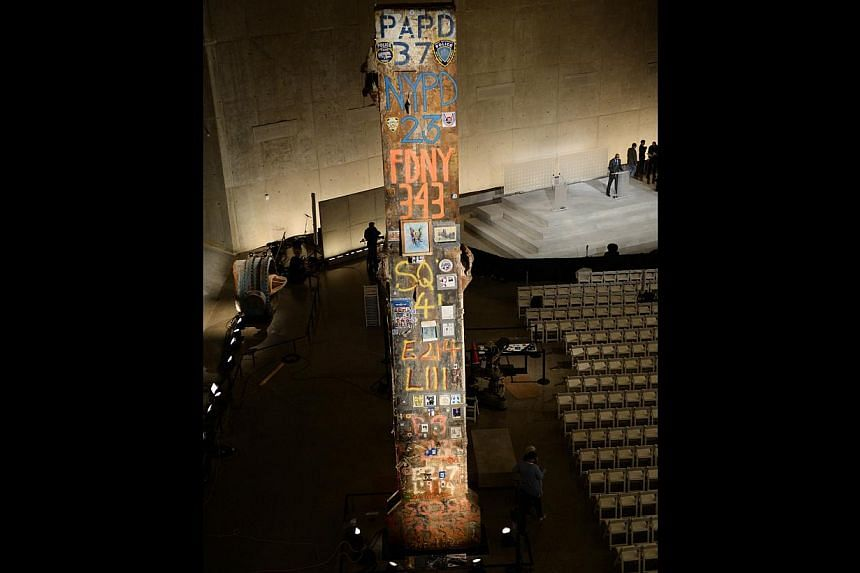 The symbolic Last Column, a steel beam from one of the World Trade Center towers, seen during a press preview of the National September 11 Memorial Museum at the World Trade Center site on May 14, 2014 in New York. -- PHOTO: AFP