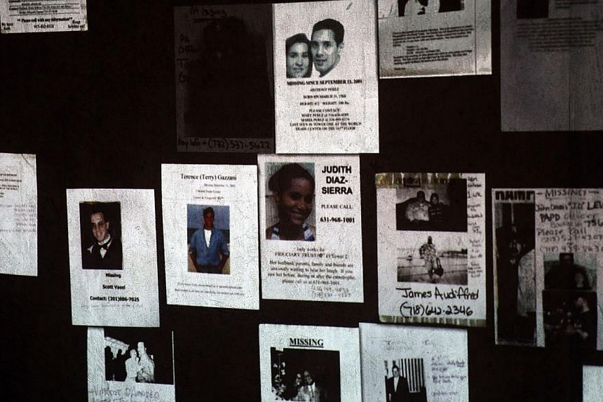 Handmade missing posters of victims of September 11 are viewed during a tour of the National September 11 Memorial Museum on May 14, 2014 in New York City. -- PHOTO: AFP