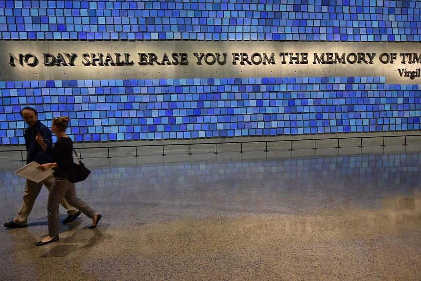 A quote from Virgil seen during a press preview of the National September 11 Memorial Museum at the World Trade Center site on May 14, 2014 in New York. -- PHOTO: AFP