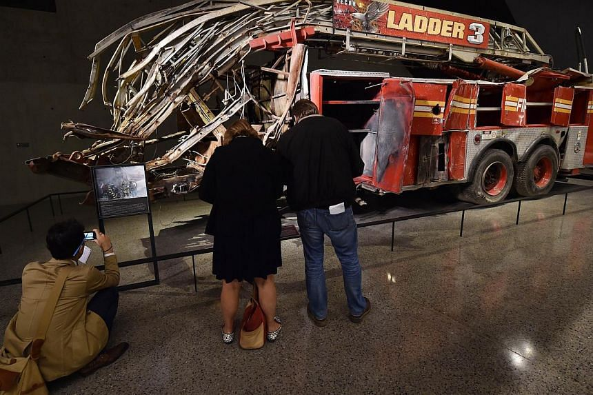 Remains of a New York City Fire Department Ladder Company 3 truck just outside the Historical Exhibition area during a press preview of the National September 11 Memorial Museum at the World Trade Center site on May 14, 2014 in New York. -- PHOTO: AF
