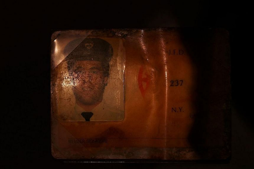 The personal identification of Glenn J. Winuk, who was killed at Ground Zero on September 11, is viewed during a tour the National September 11 Memorial Museum on May 14, 2014 in New York City. -- PHOTO: AFP