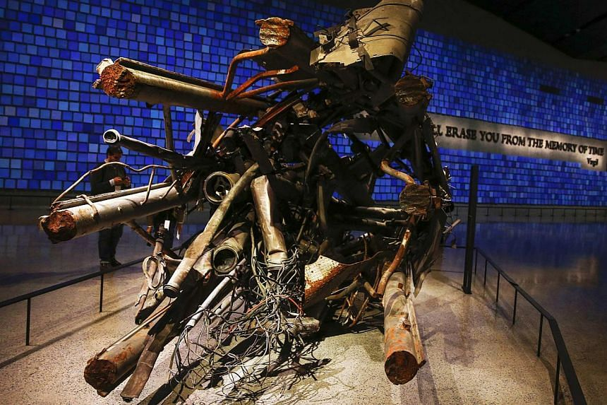 The antenna from the North Tower of the World Trade Center is seen inside the National September 11 Memorial & Museum during a press preview in New York on May 14, 2014. -- PHOTO: REUTERS