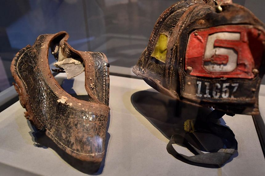 Helmets worn by New York City Fire Department Firefighter Christian Waugh on September 11, 2001,are seen during a press preview of the National September 11 Memorial Museum at the World Trade Center site on May 14, 2014 in New York. -- PHOTO: AFP