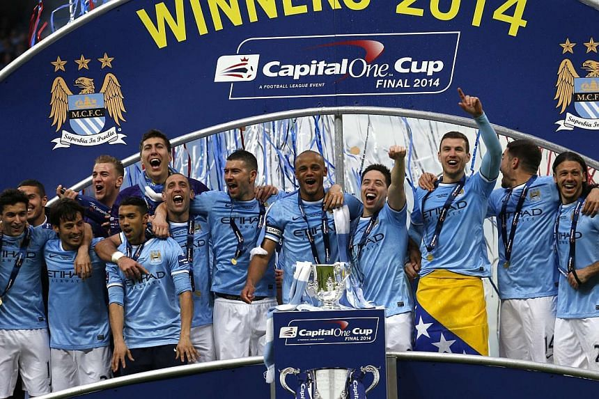 Manchester City celebrate winning their English League Cup final soccer match against Sunderland at Wembley Stadium in London on March 2, 2014. Manchester City and Paris Saint Germain have been given conditional fines of 60 million euros (S$102 milli