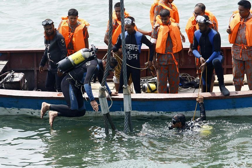 Rescue operations are undergoing for the sunken ferry MV Miraj 4 victims in the Megna River near Munshiganj, Bangladesh, on 16 May 2014.Divers battled on Friday to recover bodies trapped in the wreckage of a Bangladesh ferry that was sunk by a