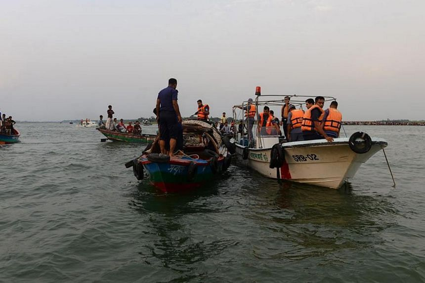 Rescue workers search for survivors after the ferry MV Miraj-4 sunk near Daulatdia in Munshiganj, Bangladesh, on 15 May 2014. -- PHOTO: EPA