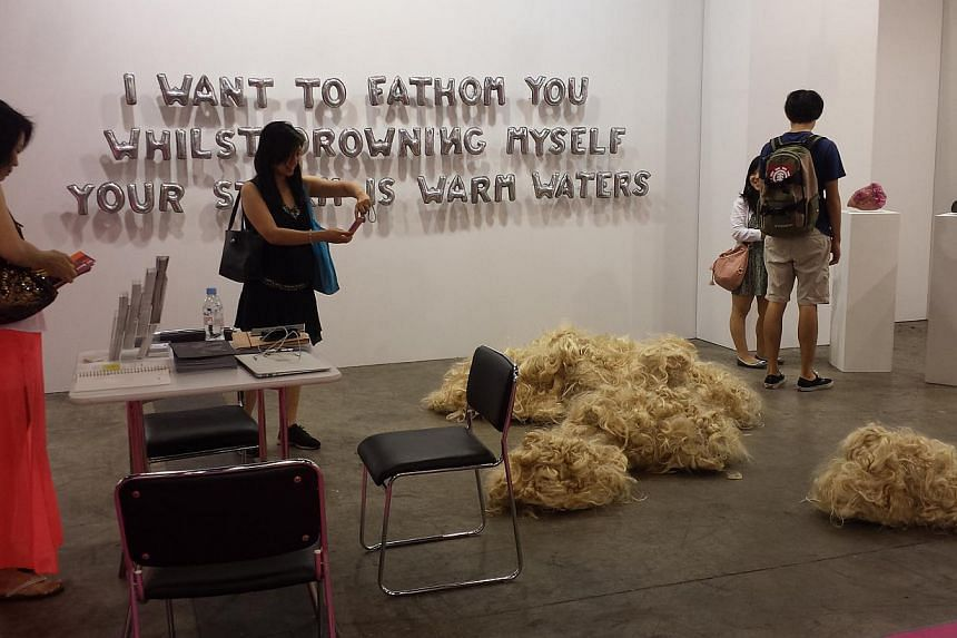 Visitors checking out works by Ang Sookoon at the booth of Fost Gallery. -- ST FILE PHOTO: HUANG LIJIE
