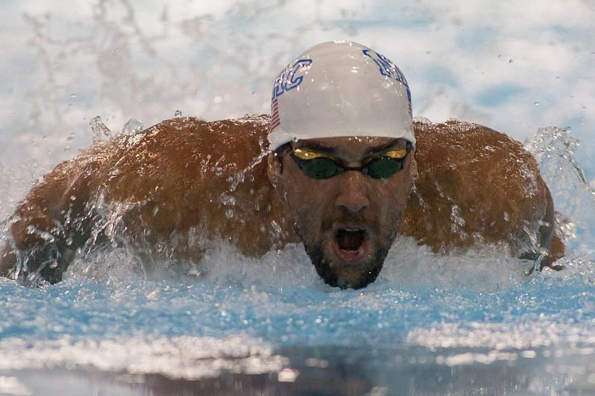 On May 16, 2014; Charlotte, NC, USA; Michael Phelps swims in the 100 meter butterfly final at Mecklenburg County Aquatic Center. -- PHOTO: REUTERS