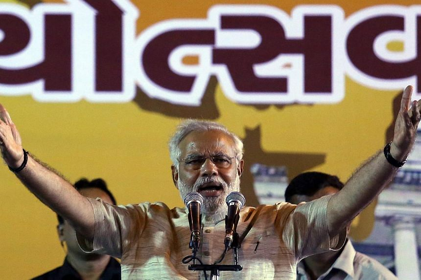 Bharatiya Janata Party's Prime Ministerial candidate and Gujarat Chief Minister Narendra Modi address a public meeting in Ahmedabad, India, on 16 May 2014. -- FILE PHOTO: EPA