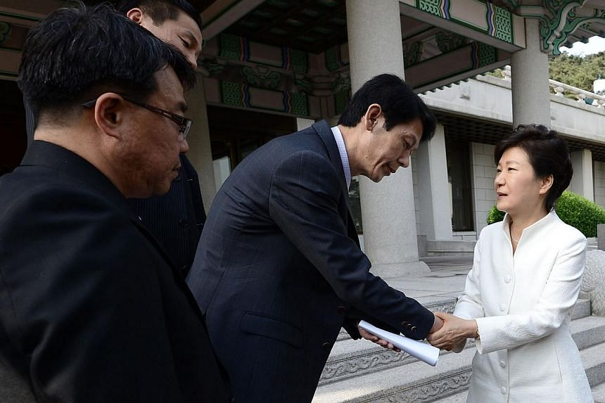 South Korean president Park Geun Hye (right) shakes hands with a family member of victims onboard sunken passenger ship Sewol after their face-to-face talk at the Presidential Blue House in Seoul, in this May 16, 2014 photo provided by Yonhap. Amid n