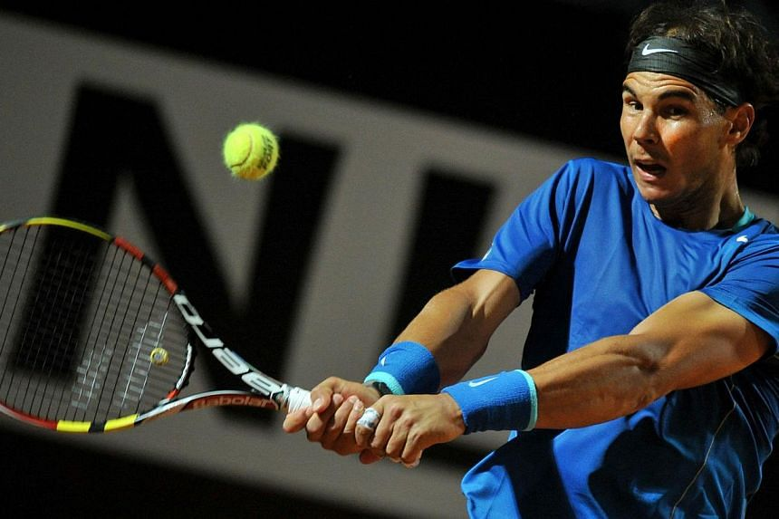 Spain's Rafael Nadal returns the ball to Britain's Andy Murray during the Rome Masters Tennis match on May 16, 2014, at the Foro Italico in Rome. -- PHOTO: AFP