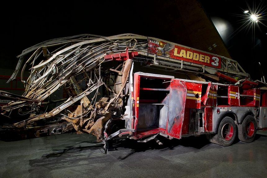 Displays at the National September 11 Memorial Museum include a fire engine from Ladder Company 3 (above) whose 11 firefighters were killed; The Last Column, the last steel beam to be removed from ground zero; and a recovery mask used by a burn victi