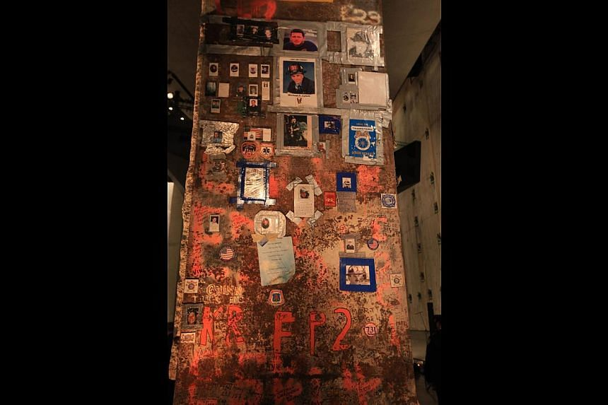 Displays at the National September 11 Memorial Museum include a fire engine from Ladder Company 3 whose 11 firefighters were killed; The Last Column, the last steel beam (above) to be removed from ground zero; and a recovery mask used by a burn victi