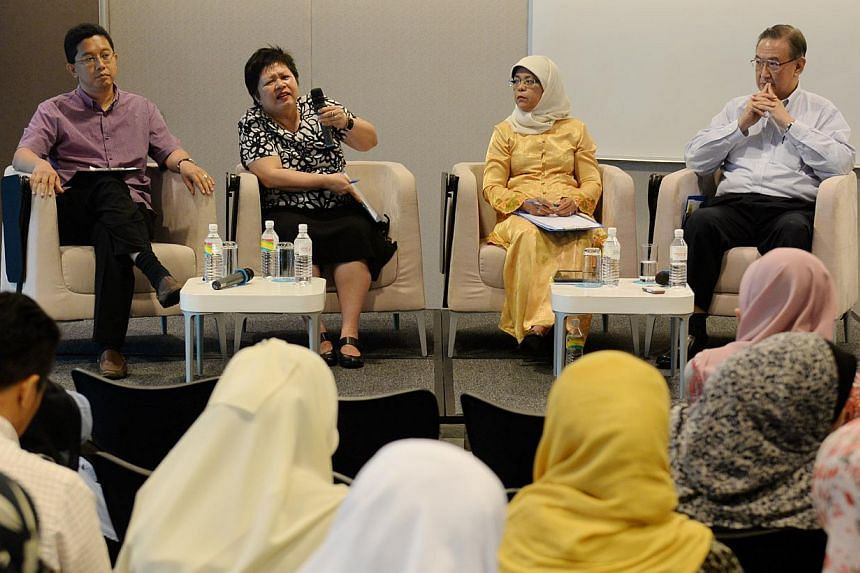 From left to right : Dr Abdul Razakjr Omar, Ms Peh Kim Choo, Speaker of Parliament Halimah Yacob and Mr Gerard Ee at a policy forum organised by self-help group Mendaki. -- ST PHOTO: AZIZ HUSSIN