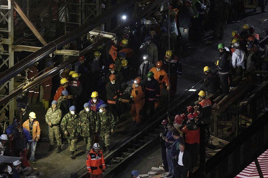 A body of miner is carried to an ambulance in Soma, a district in Turkey's western province of Manisa, on late May 16, 2014. The death toll in Turkey's worst ever mining disaster rose to 299 on Saturday as a new fire hampered rescue attempts, the ene