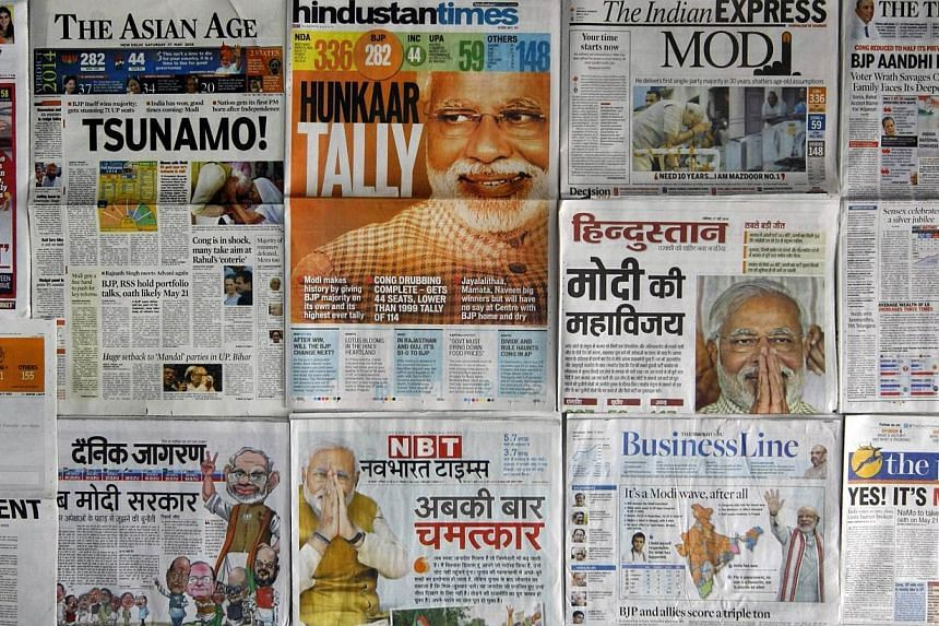 A selection of front pages of Indian newspapers with news of the election victory of Bharatiya Janata party (BJP) prime-ministerial candidate Narendra Modi in New Delhi on May 17, 2014.Indian newspapers on Saturday urged prime minister-elect Narendra