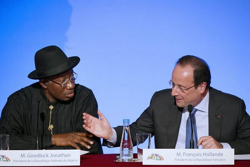 Nigeria's president Goodluck Jonathan (left) and French president Francois Hollande give a press conference following a summit on the threat from Islamist sect Boko Haram at the Elysee palace, on May 17, 2014 in Paris. -- PHOTO: AFP