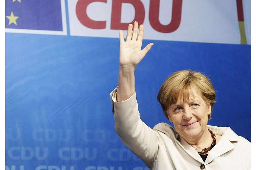 German Chancellor Angela Merkel waves as she arrives for an election rally in Berlin on May 14, 2014. -- FILE PHOTO: REUTERS