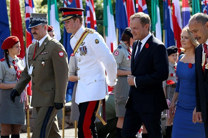Polish Prime Minister Donald Tusk (centre) with his wife Malgorzata Tusk (second right), Britain's Prince Harry (second left), New Zealand Governor General Sir Jerry Mateparae (right) and Polish General Wieslaw Grudzinski (left) arrive for the offici