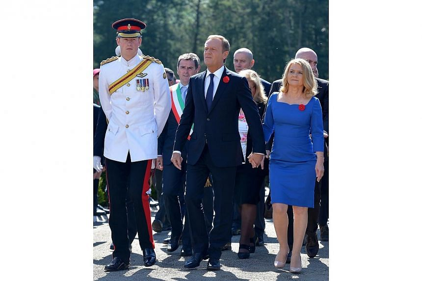Polish Prime Minister Donald Tusk (centre) with his wife Malgorzata Tusk (right) and Britain's Prince Harry (left) arrive for the official ceremony marking the 70th anniversary of the Battle of Monte Cassino, in Monte Cassino, Italy, 18 May 2014. --